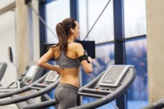 rp_photodune-9922017-woman-with-earphones-exercising-on-treadmill-xs-230x153.jpg