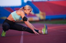 sporty woman on athletic race track