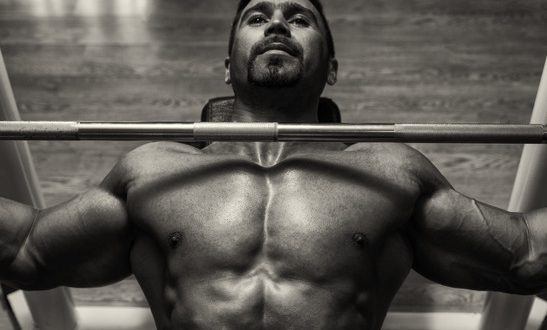 Mexican Bodybuilder Working Out Chest With Barbell