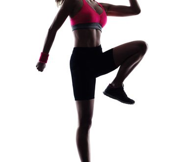 one woman fitness jumping  exercises  in studio silhouette isolated on white background