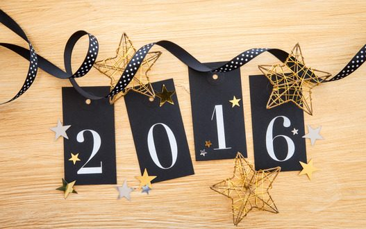 2016 written on gift tags with glittery christmas decoration