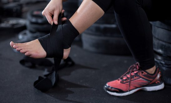 Girl with ankle injury preparing to workout