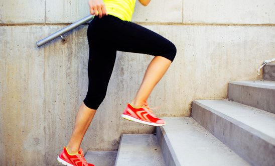 Woman running up the stairs, interval training