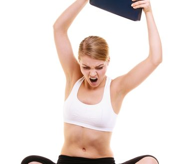 Slimming diet weight loss. Upset frustrated angry young woman girl screaming shouting and throwing weighing scale. Healthy lifestyle concept. Isolated on white background.