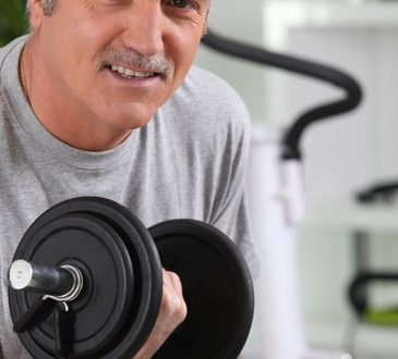Mature man working out with a dumbbell