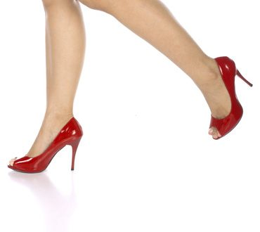 Woman wearing red shoes isolated over white background
