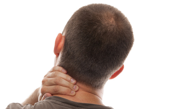 Back View of a Man with Neck Pain