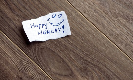 Happy Monday written on piece of paper, on a wood background. Space for your text.