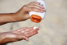 close up of women hands receiving sunblock cream lotion