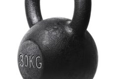 A rough and tough heavy 30 kg 66 lbs cast iron kettlebell isolated on white with natural reflection.
