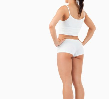 Portrait of the back of a healthy woman against a white background