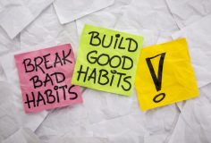 break bad habits, build good habits - motivational reminder on colorful sticky notes - self-development concept