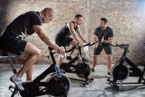Cardio training on bicycle, sport and healthy lifestyle
