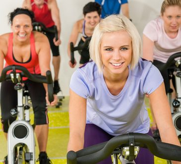 Young woman at spinning class enjoy workout