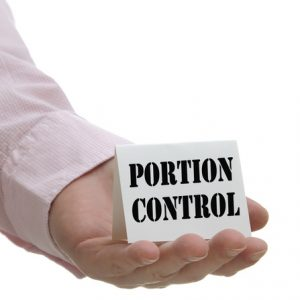 Business people holding portion control sign