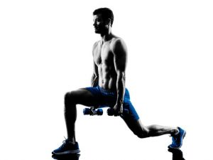 one caucasian man exercising lunges  fitness weights exercises in studio silhouette isolated on white background