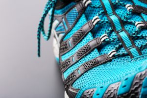 Closeup of blue running shoe