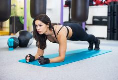 training fitness woman doing plank core exercise working out for back spine and posture Concept pilates sport