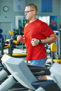 cardio-fitness jogging at treadmill