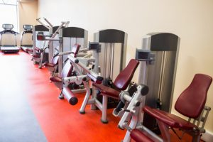 Row of weights machines at the gym