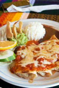 A typical mexican dish, enchiladas with romato and cheese