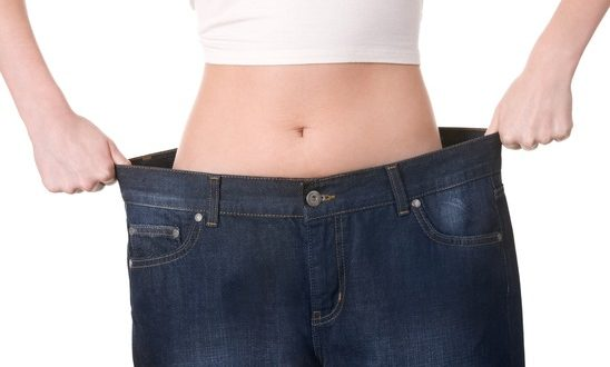 Close-up of female figure with jeans of inappropriate size