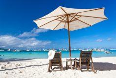 Sun umbrella with chair longue on tropical beach
