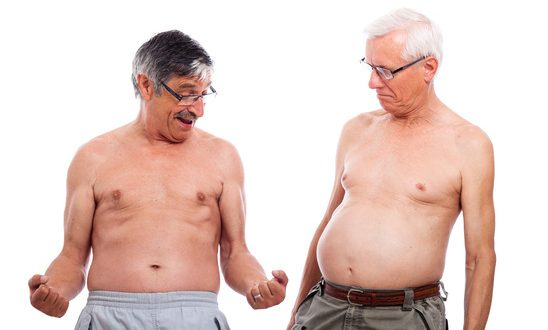 Two happy naked senior men comparing body shape, isolated on white background.