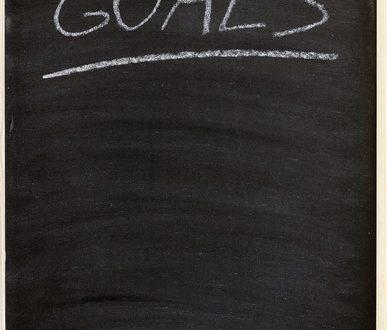 the goals word written on a blackboard