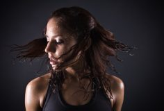 sweating girl after workout shake her head