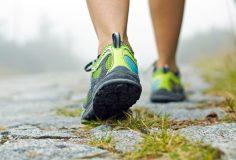 Woman walking in mountains in sport shoes